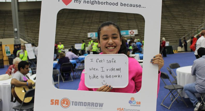 Child expressing her neighborhood love at SA Tomorrow planning session